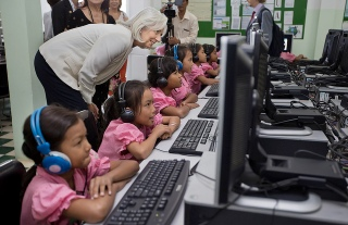 International Monetary Fund Managing Director Christine Lagarde watches school girls in the computer room at Toutes à l'Ecole school December 3, 2013 in Kandal province of Cambodia. Lagarde is on a three country visit to Asia. IMF Photograph/Stephen Jaffe