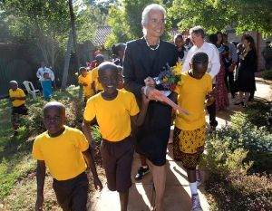 International Monetary Fund Managing Director Christine Lagarde walks with some children after she visited the Nest Home, an orphanage and halfway house for children January 7, 2014 in Nairobi, Kenya. Lagarde is on a two country visit to Africa. IMF Photograph/Stephen Jaffe