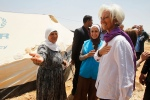 Christine Lagarde, IMF Managing Director, speaks to Syrian refugee woman during visit to Syrian al-Za'atari refugee camp in Mafraq city